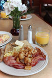 Plate of breakfast. Home fries and bacon and eggs Stock Photography