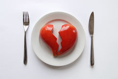 Plate with broken heart Stock Images