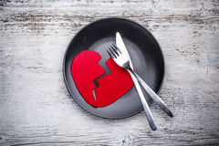 Plate with broken heart Royalty Free Stock Images