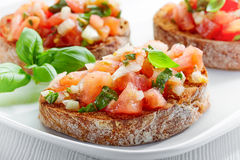 Plate of bruschettas royalty free stock photos