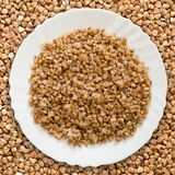 Plate with buckwheat Royalty Free Stock Photos