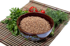 Plate with buckwheat, a row parsley, tomatoes, fennel Royalty Free Stock Image