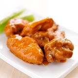 Plate of buffalo wings with celery. Royalty Free Stock Image