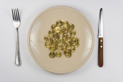On the plate is bunch of Russian ten-coin lying near tableware view from above Royalty Free Stock Image