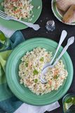 Creamy cabbage coleslaw. A plate of cabbage coleslaw salad with creamy dressing and parsley, white serving spoons stock images