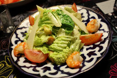 Plate of caesar salad with shrimps Royalty Free Stock Photography