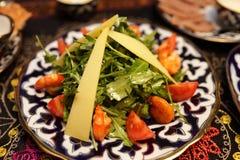 Plate with caesar salad on a table Stock Photos