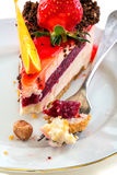 Plate of cake with fresh strawberries and orange. Royalty Free Stock Photography