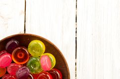 A plate of candy in the corner of the frame. Copyspace. Royalty Free Stock Images