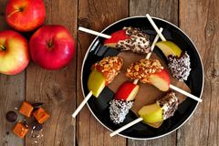 Plate of caramel and chocolate dipped apple slices, overhead scene Royalty Free Stock Images