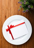 Plate with card Royalty Free Stock Photos