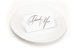 Plate with card signed thank you Royalty Free Stock Photography