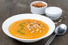 Plate of carrot soup with almonds and cress salad Stock Photos