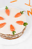 Plate with carrot sponge cake and little orange Stock Image