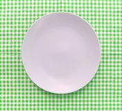 The plate on checkered tablecloth Stock Photo