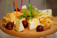 Plate of cheese. Some appetizing food at banquet table stock images