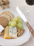 Plate of Cheese and Biscuits with a Glass of Port. And a Cheese Knife Royalty Free Stock Images