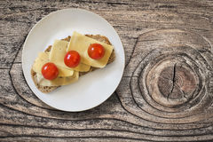 Plate With Cheese And Cherry Tomato Sandwich On Wooden Block Stock Photos