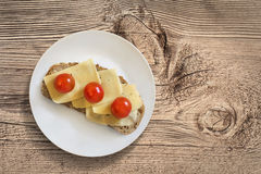 Plate With Cheese And Cherry Tomato Sandwich On Wooden Block Stock Photo