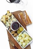Plate of cheese and fruits on a table stock photo