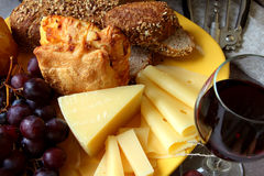 Plate of cheese and a glass of wine. Royalty Free Stock Images