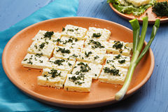 Plate of cheese with greens Stock Photos