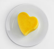 Plate with Cheese in a heart shape isolated on white background Stock Image