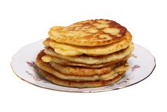 Plate of cheese pancakes. On the white background Stock Photography