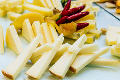 Cheese and peppers. A plate of cheese and peppers on a buffet table Royalty Free Stock Photo