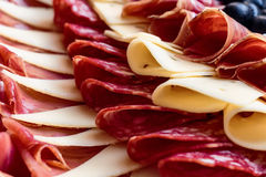 Plate of cheese, prosciutto and salami Royalty Free Stock Images