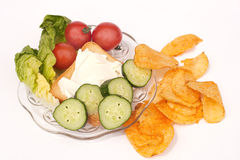 Plate with cheese, salad & crisps Stock Photo