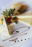 Plate with cheese slices and olives Stock Photo