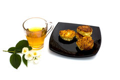 Plate with cheesecakes and flower tea Royalty Free Stock Images