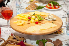 A plate of cheeses and salads on the holiday table Stock Image