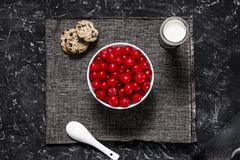 Plate of cherries with milk and cookies. royalty free stock images