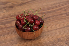 A plate of cherries. On the wooden table, healthy snack stock photo