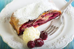 Plate with cherry strudel closeup. Stock Image