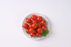 Plate of cherry tomatoes Royalty Free Stock Photography