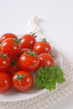Plate of cherry tomatoes Stock Photo