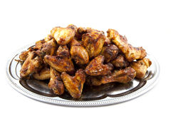 Plate with chicken. Chicken legs and wings isolated over white royalty free stock image