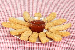Plate of chicken fingers with BBQ sauce Stock Images