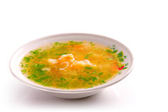 Plate of chicken soup. Isolated over white royalty free stock photography