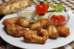 Plate with chicken wings with lepinja and sauces Royalty Free Stock Image