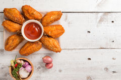 Plate of chicken wings on wood. En table Royalty Free Stock Photo