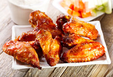 Plate of chicken wings. On wooden table Royalty Free Stock Images