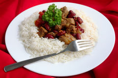 Plate of chili con carne on a red background cloth Royalty Free Stock Photo