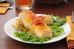 Plate of chimichangas with cheese Stock Photo