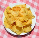 Plate of chips. Potato chips on a table seen from above royalty free stock image