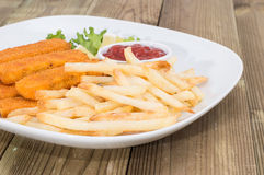 Plate with Chips and Fish Fingers Royalty Free Stock Images