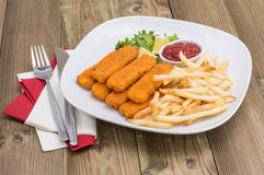 Plate with Chips and Fish Fingers Stock Photography